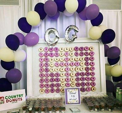 Yellow and purple donut wall cross