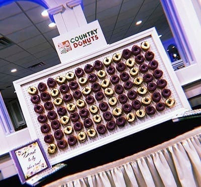 80 gold and purple donut wall