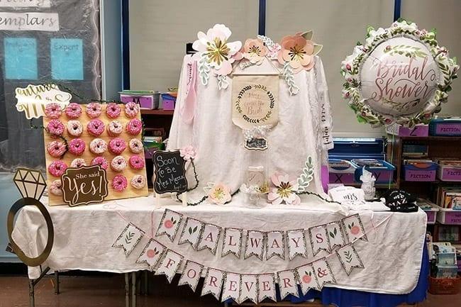 pink donut wall at a bridal shower
